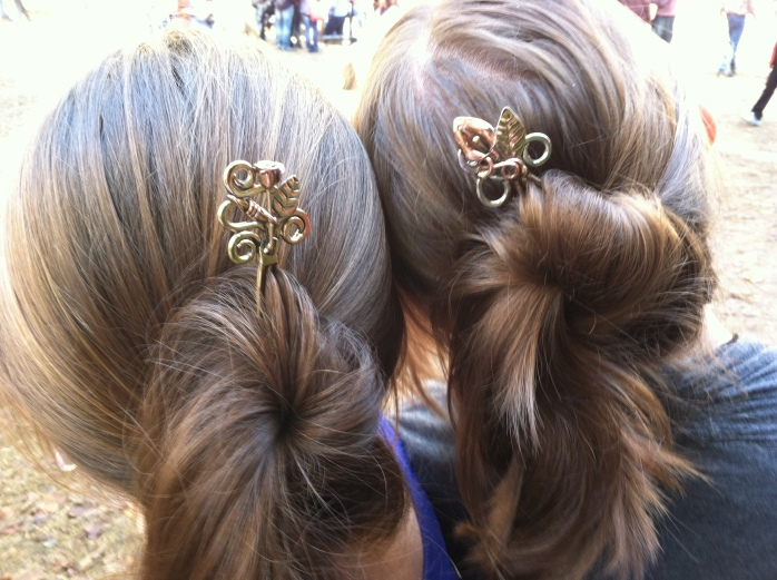 """My daughters' hair with """"hair sticks"""""""