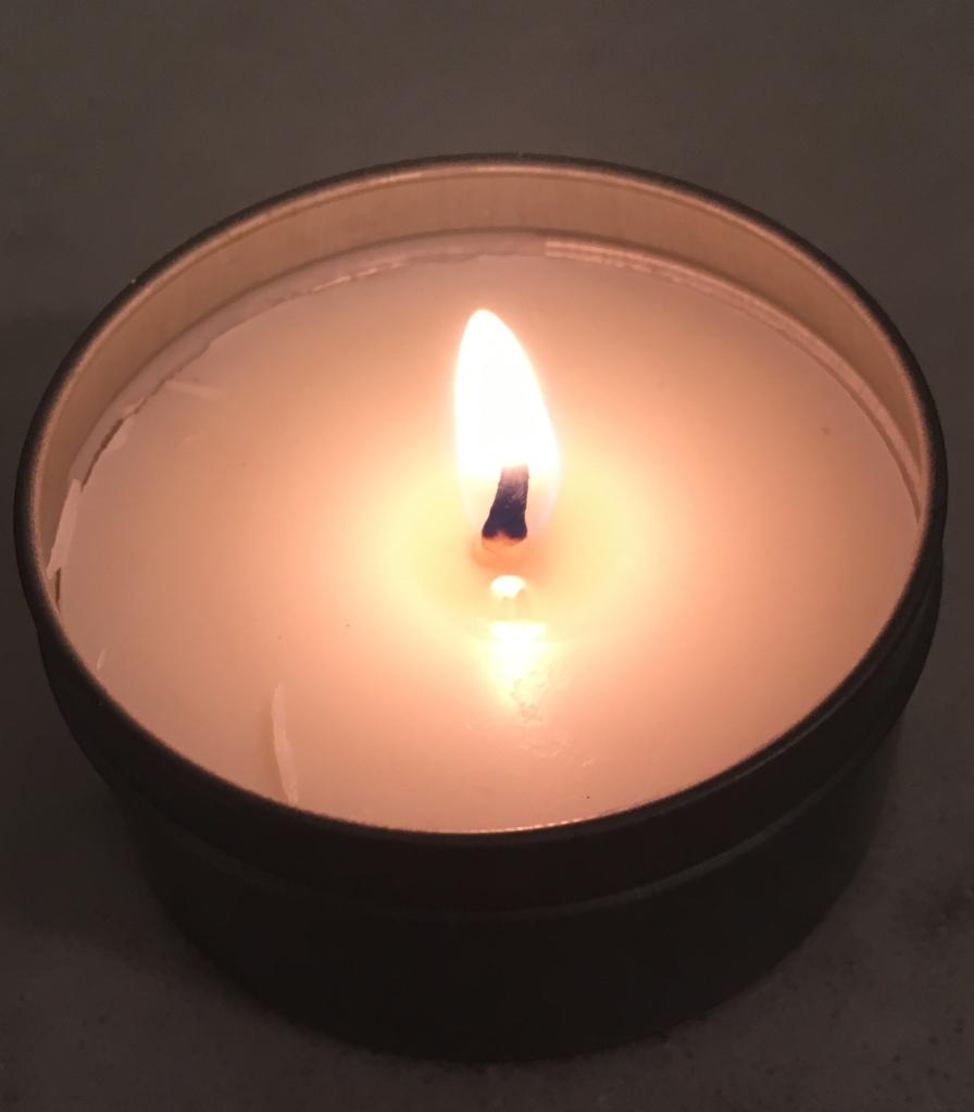 A lit votive candle